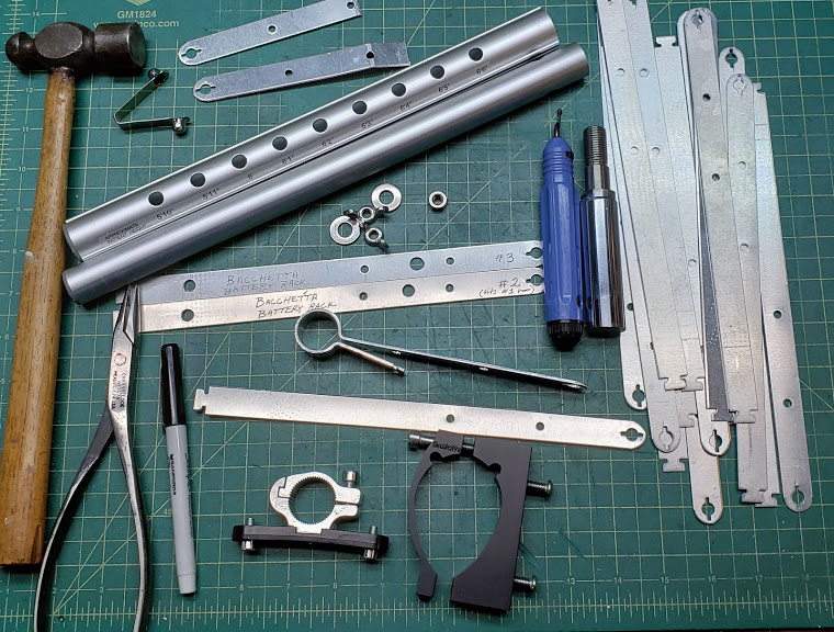 eg20_diy_battery_rail_and_frame_clamps_on_workbench_photo